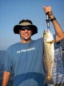 Darren catching a fish ona tampa fishing charter